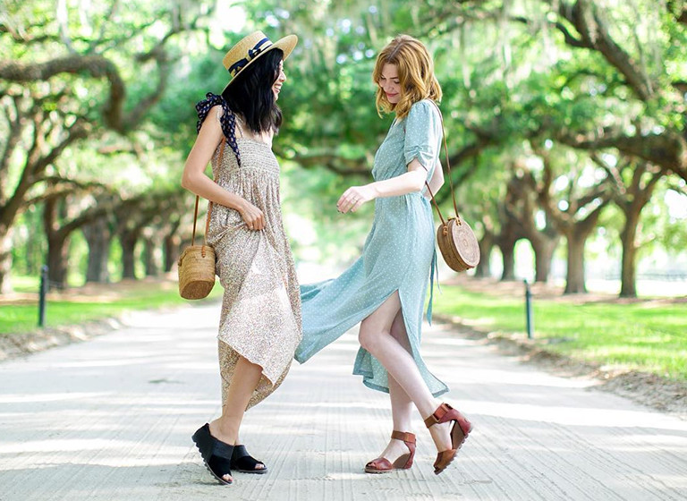 Two young women in wedge sandals.