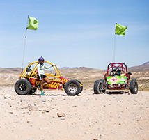 Faith and Mark in their dune buggies.