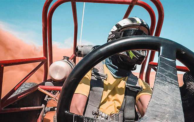 Mark at the wheel of a dune buggy.