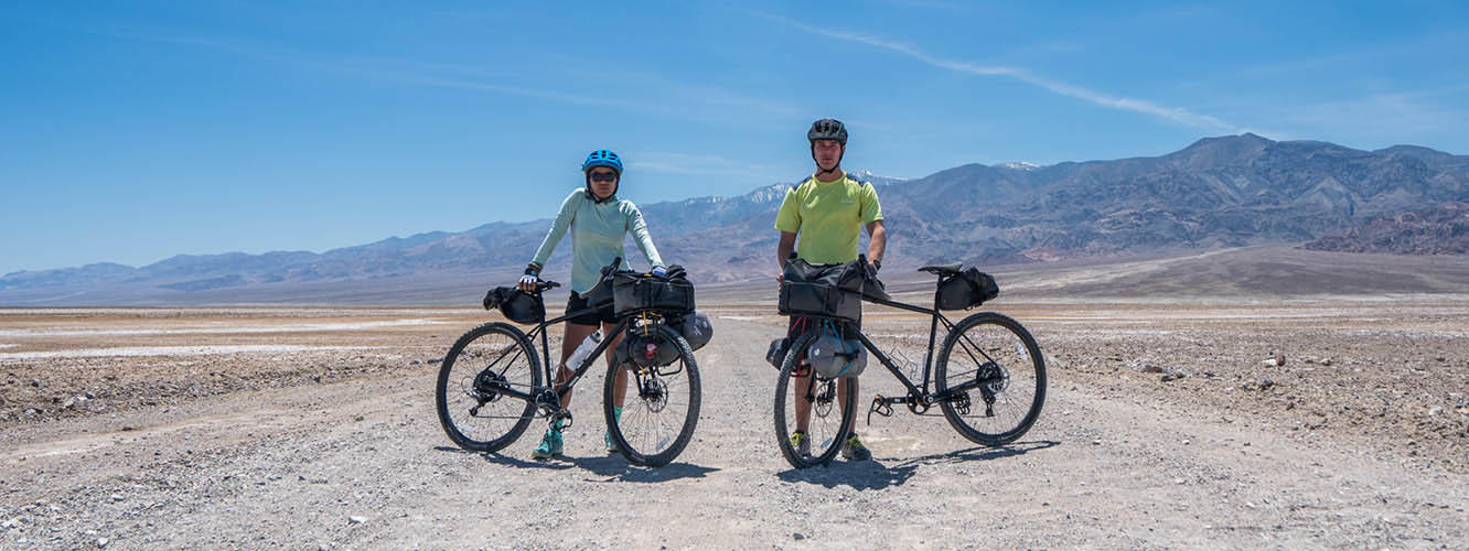 Faith and Mark stand with their bikes in the heart of Death Valley; Video of Death Valley challenge