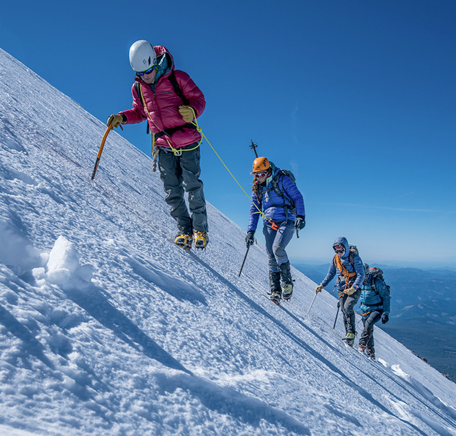 Faith, Mark, and their mountain guides slowly make their way up a very steep, snowy incline on Mt. Shasta.