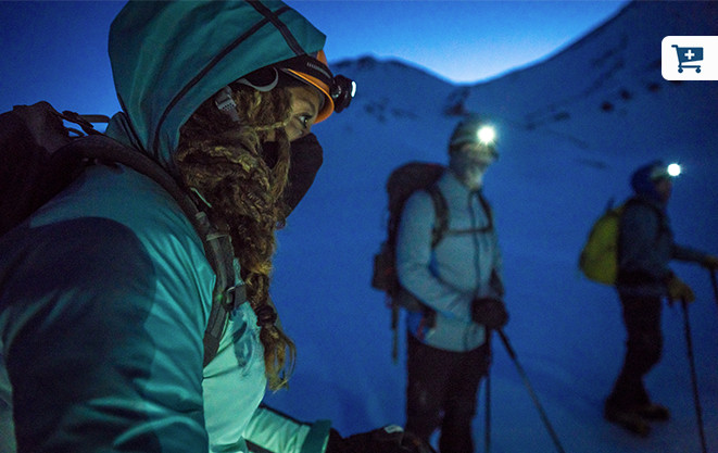 Headlamps on and faces covered for warmth, Faith and Mark get ready to begin their summit ascent in pre-dawn darkness.