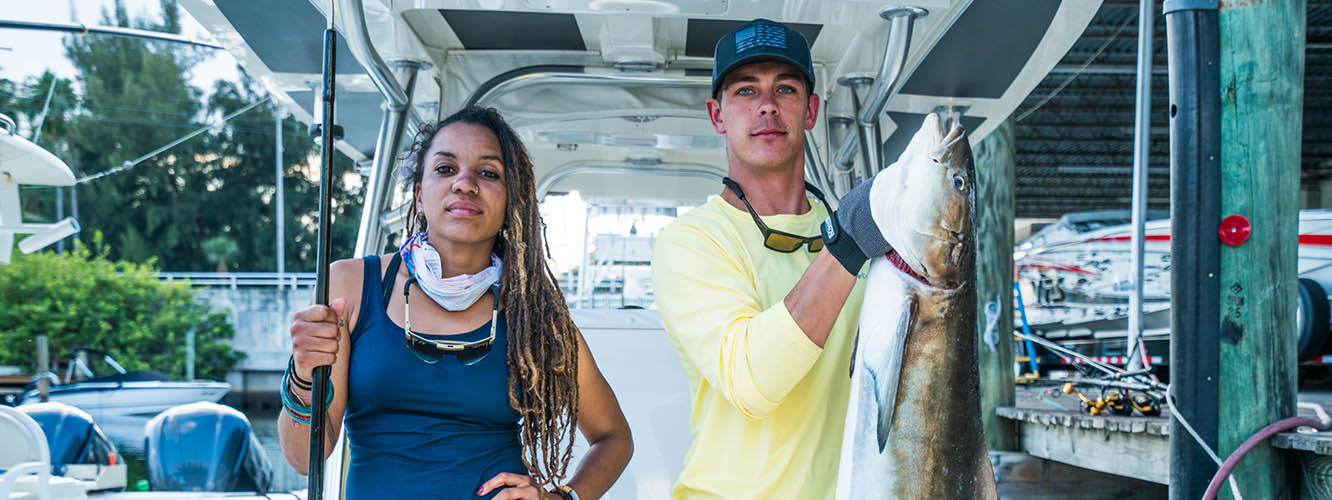 Faith and Mark pose with the prize catch; Video of the fishing challenge in Miami