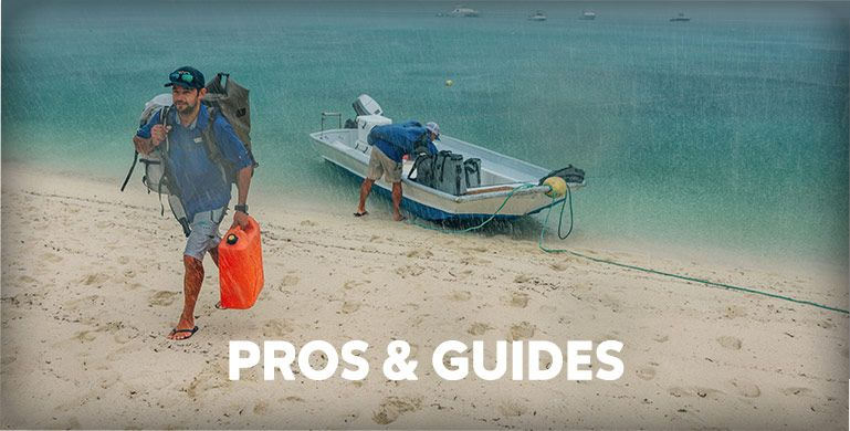 An  angler on the beach, Pros & Guides.