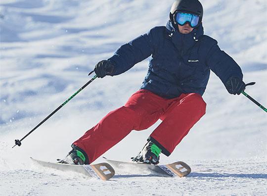A man skiing down the mountain in Columbia gear.