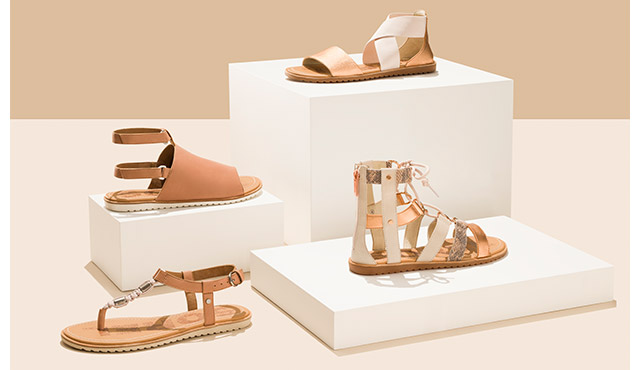Close-up of the Ella collection, including tan and white Ella Lace, Ella Sandal, Ella Mule, and Ella T-Strap.