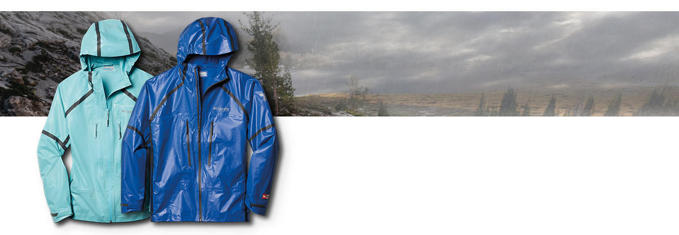 Close-up of a Columbia jacket. Rainy landscape.