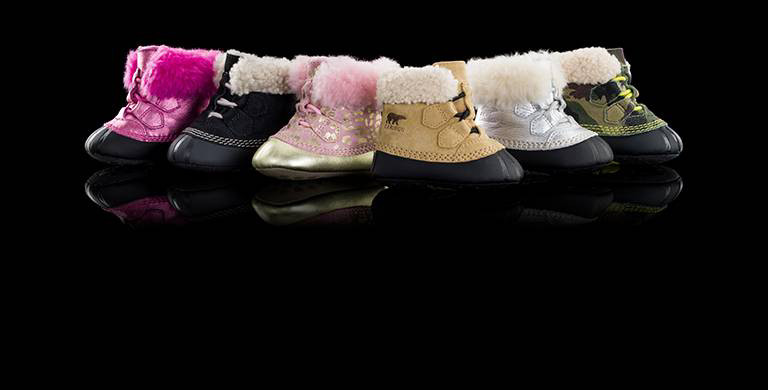 Six infant Sherpa-lined booties.