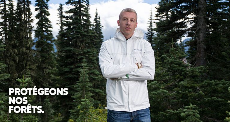 Image of Macklemore standing in a forest