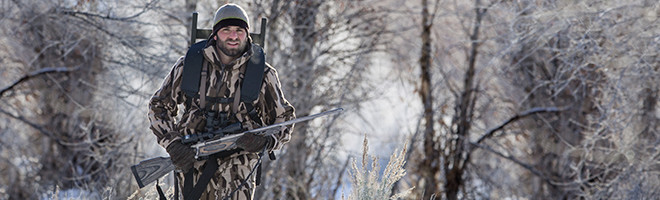 A hunter wearing Columbia camouflage hunting clothes.