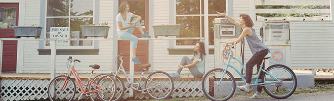 Three women taking a break from a bike ride.