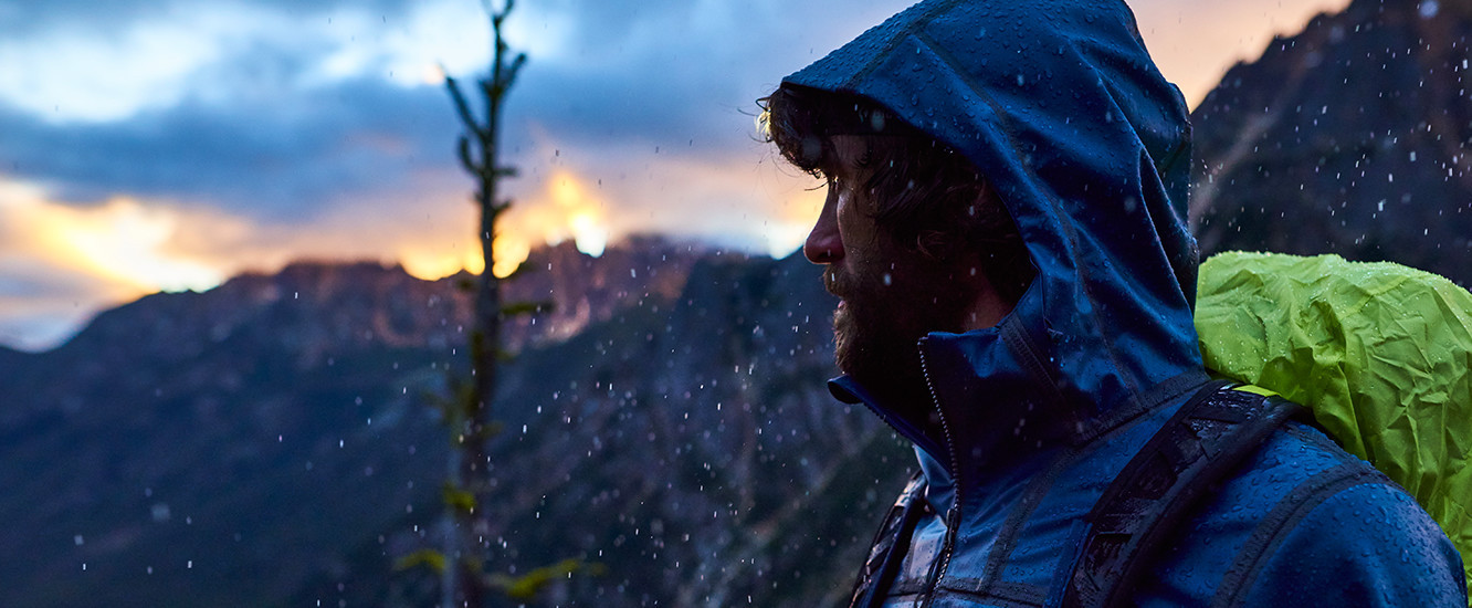 A man hiking the PCT at dusk