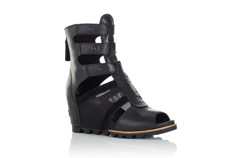 A black gladiator wedge sandal on white background.