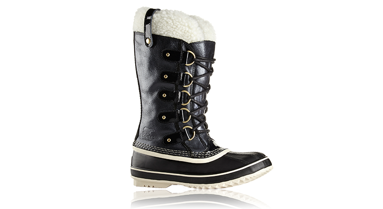 a black snow boot on a brown background