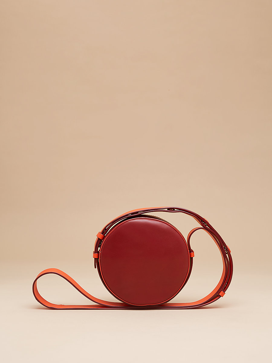 Leather Circle Handbag in Red Wine/ Blood Orange by DVF