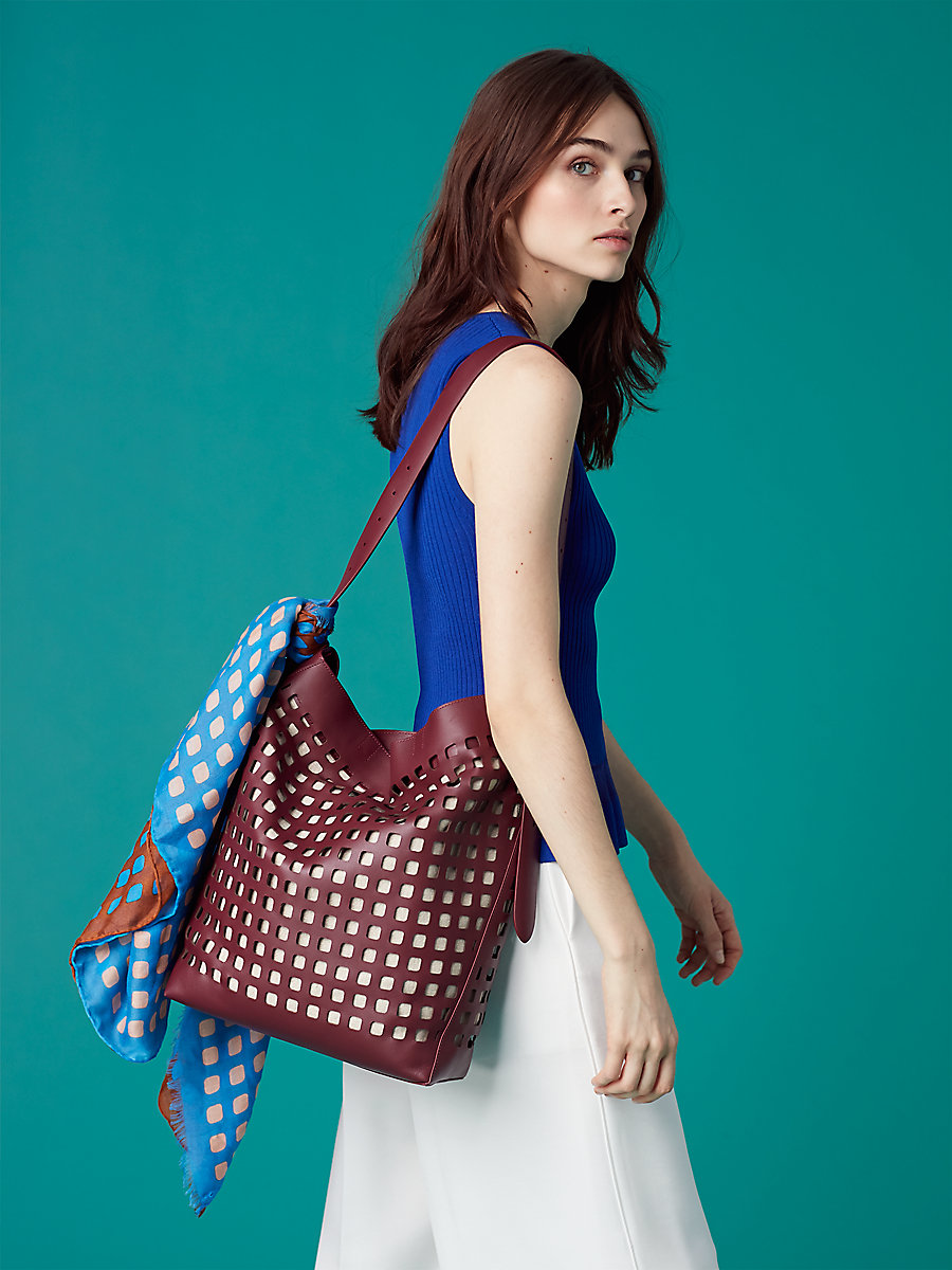 Perforated Origami Bucket Bag in Red Wine by DVF