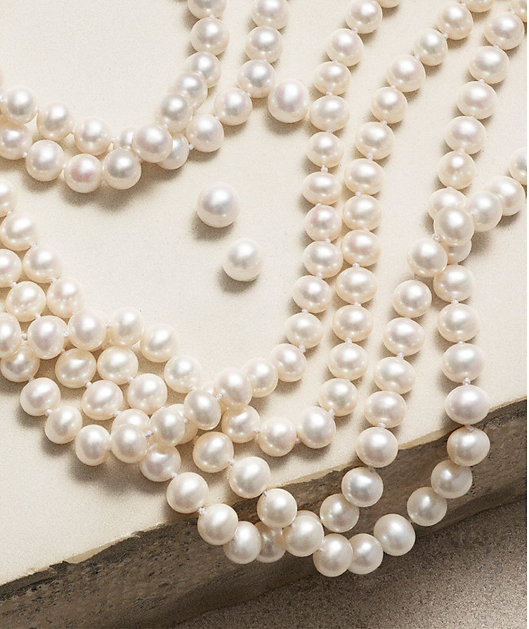 Necklaces with cultured freshwater pearls and diamonds.