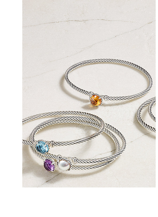 Châtelaine® bracelets in sterling silver with citrine, blue topaz, white cultured freshwater pearl and amethyst on a stone.
