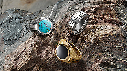 Southwest rings in sterling silver with turquoise, 18K gold with black onyx and a sterling silver arranged on the ridges of a multicolored stone.