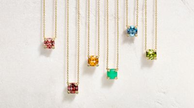 Chatelaine® pendant necklaces in 18K yellow gold with colored gemstones.