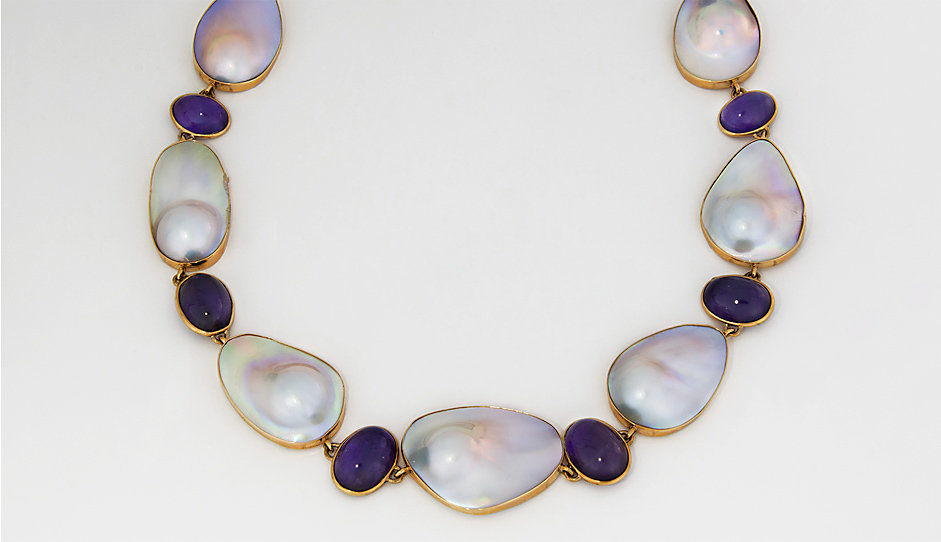 A pearl and gemstone necklace