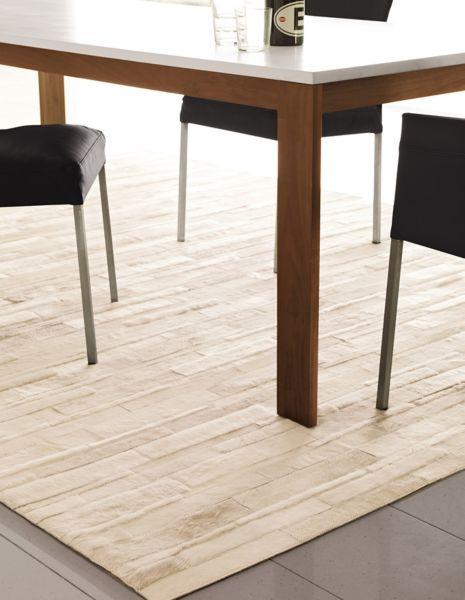 thin strip cowhide rug
