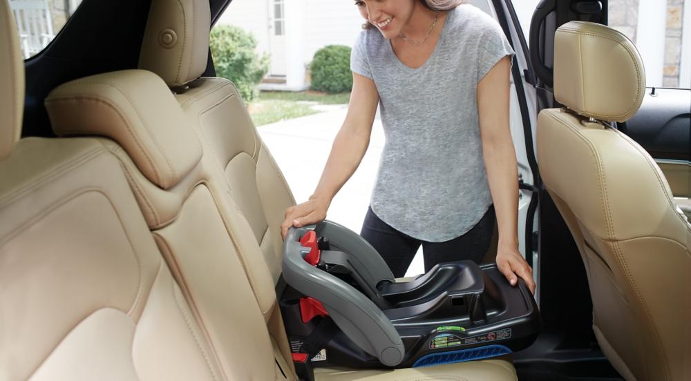 Woman Installing LATCH Car Seat