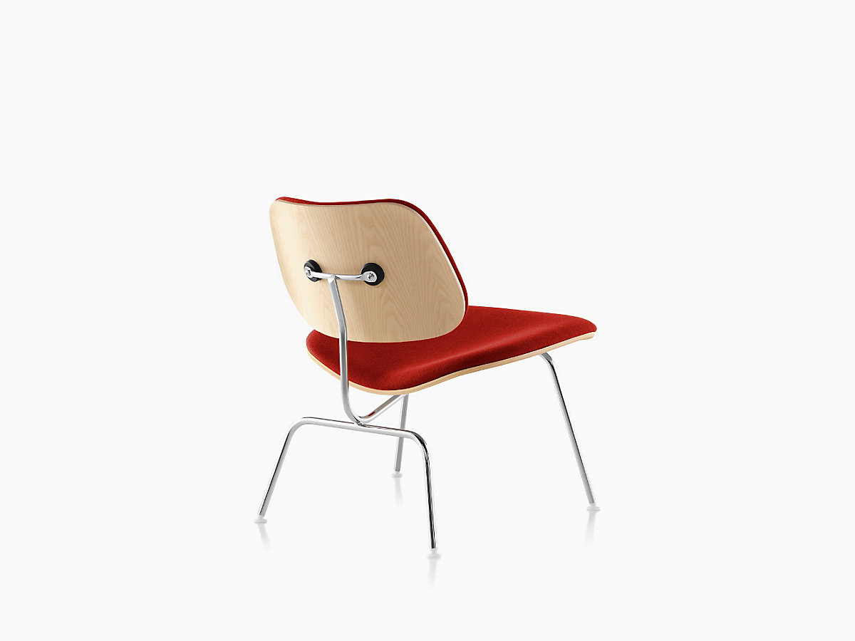eames molded plywood lounge chair with metal base upholstered