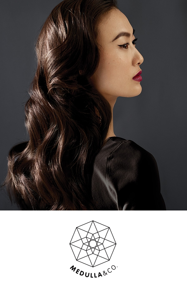 Holt Renfrew Image Of Model With Her Hair Done By Medulla & Co. With The Medulla & Co. Logo On The Side.