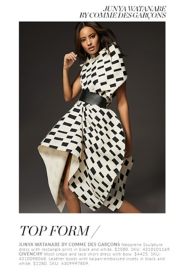 Holt Renfrew Woman Wearing Neoprene Sculpture Dress With Rectangle Print In Black And White From Junya Watanabe By Comme Des Garçons. Woman Wearing Wool Crepe And Lace Short Dress With Bow From Givenchy.