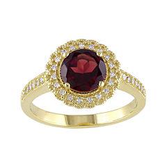 Genuine Garnet and 1/7 CT. T.W. Diamond Ring