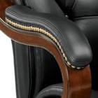 Exquisite, curved wood arms with nailhead trim and