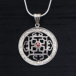 View Silver and Garnet Mandala Necklace image