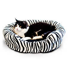 Self Warming Nuzzle Nest Zebra Pet Bed