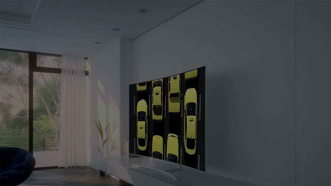 QLED TV is displayed in a living room with the wide-open view outside.