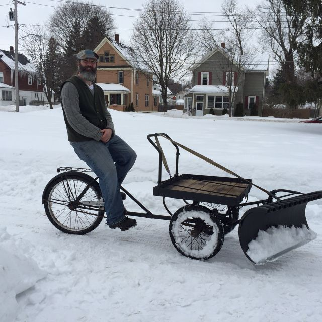 Cortland man builds uses bicycle that plows