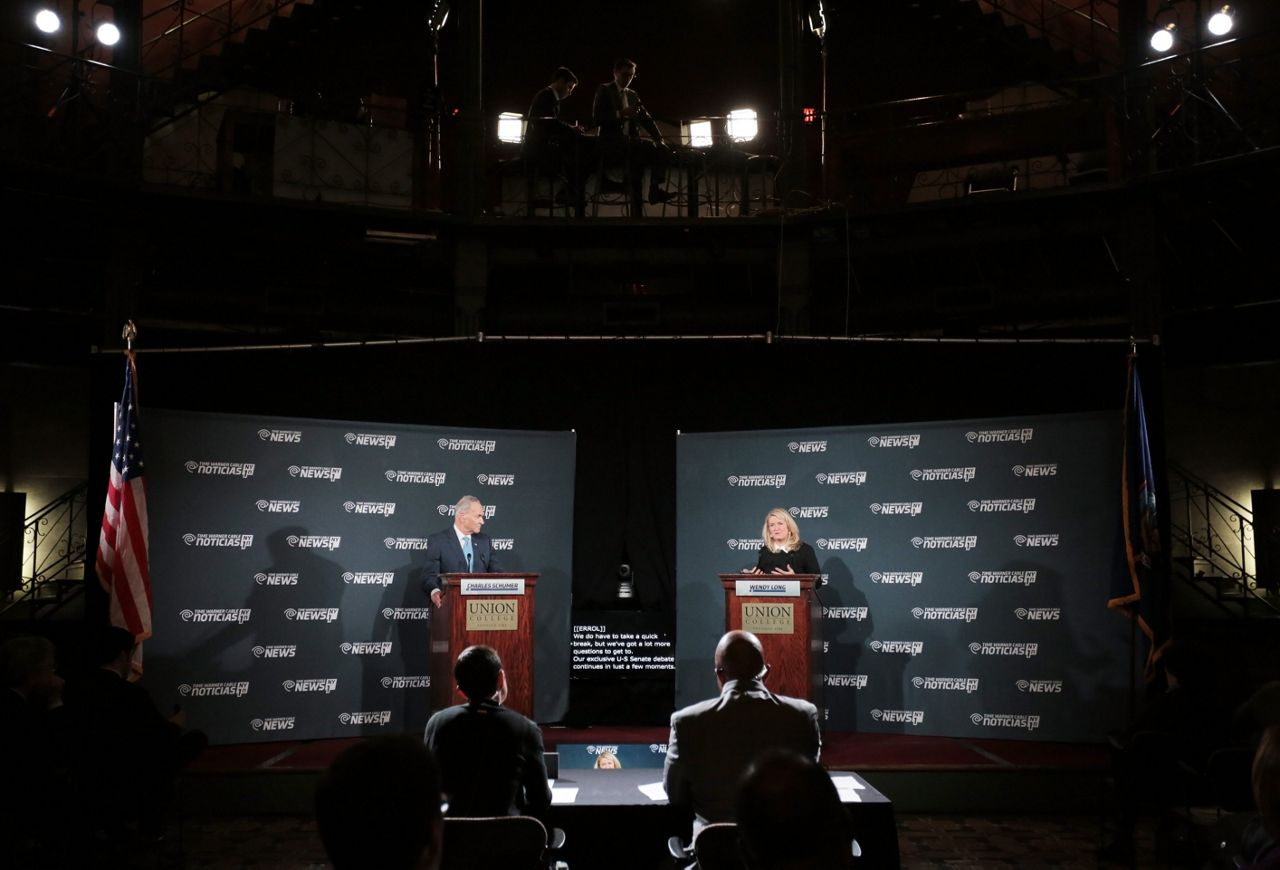 Schumer, Long Trade Jabs in U.S. Senate Debate