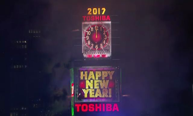 as the ball drops revelers ring in the new year in times square