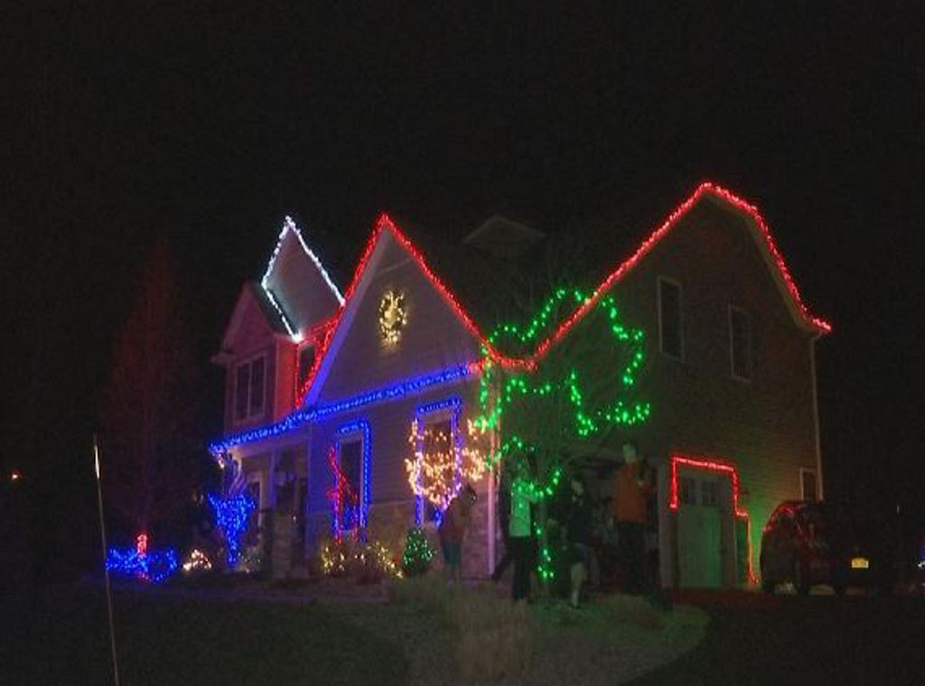 11 year old carries on christmas light tradition