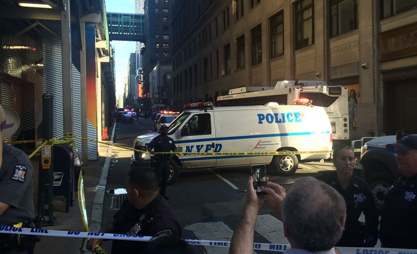 NY Police: Man with meat cleaver shot by officers after attack