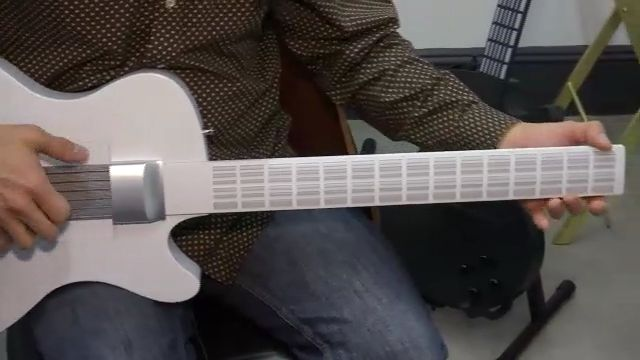 Magic Instruments Guitar\' Lets You Play Chords Using a Single Finger