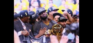 OAKLAND, CA - JUNE 19:  LeBron James #23 of the Cleveland Cavaliers holds the Larry OBrien Champion