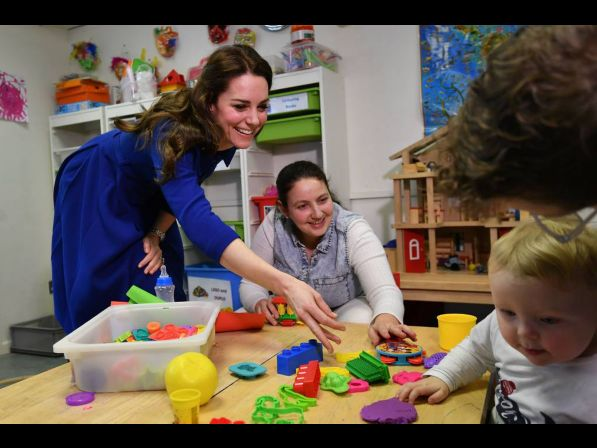 Catherine, Duchess of Cambridge (L) meets attendees at the Early Years Parenting Unit