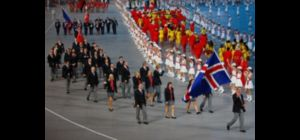 BEIJING - AUGUST 08:  Orn Arnarson of the Iceland Olympic team carries his countrys flag to lead ou