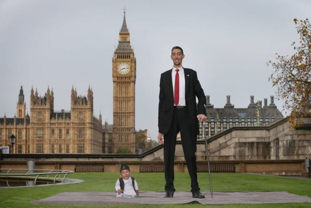 The shortest man ever, Chandra Bahadur Dangi meets the worlds tallest man, Sultan Kosen for the very first time on November 13, 2014 in London, England. Chandra from Nepal measuring 54.6 cm (21.5 inches) posed for photographers with Sultan from Turkey who is 251 cm (8 ft 3 inches). Today is the 10th annual Guinness World Records Day during which thousands of people are expected to come together to celebrate the international day of record-breaking!