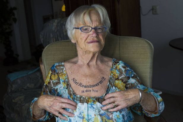 91-one-year old Nel Bolten has a tattoo on her chest that says: 'Do not reanimate, I am 91+' on November 15, 2014 in The Hague, The Netherlands. Dutch Health Minister Edith Schippers has declared that this tattoo is a legal declaration that gives Nel Bolten the right to self determination to end her life. Euthanasia and self determination to end one's life are complex issues in The Netherlands with an ever increasing population of eldery people.