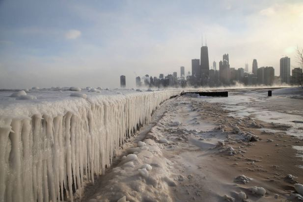 Ice builds up along Lake Michigan at North Avenue Beach as temperatures dipped well below zero on January 6, 2014 in Chicago, Illinois. Chicago hit a record low of -16 degree Fahrenheit this morning as a polar air mass brought the coldest temperatures in about two decades into the city.