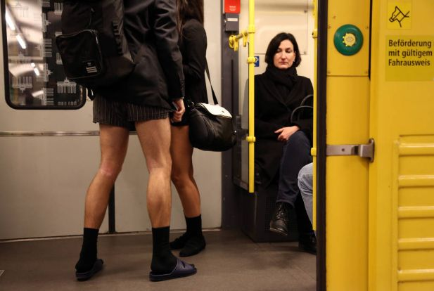 A unsuspecting subway passenger looks at participants of the No Pants Subway Ride on January 12, 2014 in Berlin, Germany. The annual event, in which participants board a subway car in January while not wearing any pants while behaving as though they do not know each other, began as a joke by the public prank group Improv Everywhere in New York City and has since spread around the world, with enthusiasts in around 60 cities and 29 countries across the globe, according to the organization's site.