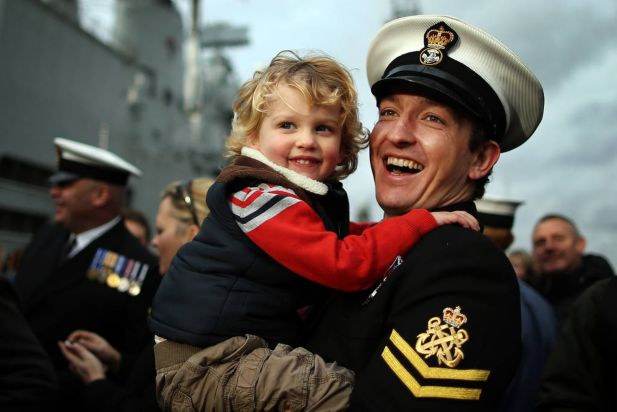 Petty Officer Andrew Boote holds his son Max Boote, 3, after disembarking HMS Illustrious on Portsmouth Harbour on January 10, 2014 in Portsmouth, England. The ships returns with her 650 crew after a five month deployment to South East Asia delivering Aid relief to victims of Typhoon Haiyan in the Philippines.