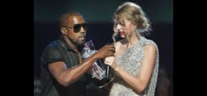 FILE - In this Sept. 13, 2009 file photo, singer Kanye West takes the microphone from singer Taylor